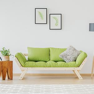 תמונה של ספה מעוצבת בצבע ירוק